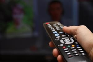 tv-hand-remote-shutterstock